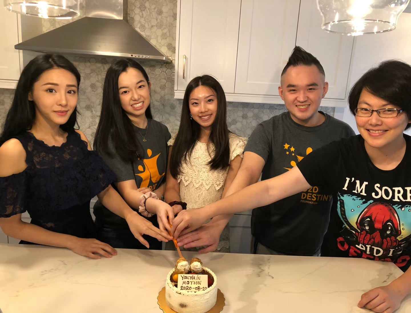 Young Ambassador members cut a cake to celebrate youth in motion