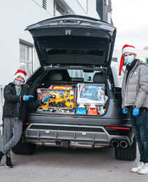 Landon and Bear pose with a trunk full of goodies for BC Children's Hospital